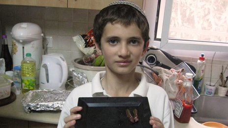 Ari Zivotofsky's son Menachem with some chocolate-covered locust