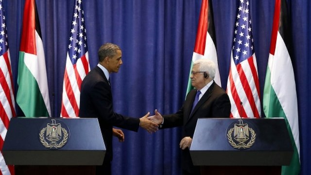 US President Obama and Palestinian President Abbas shaking hands