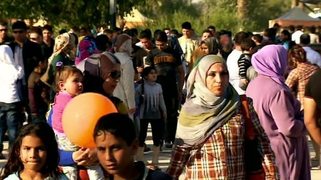 Iraqi families enjoying the sunshine in a park in Baghdad