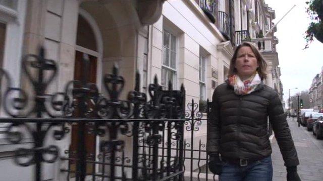 Stephanie Flanders walks down a London street