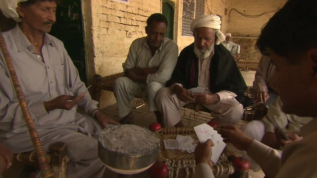 Men playing cards in Pakistan