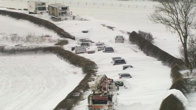 Vehicles buried in snow drifts in Cumbria