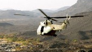 French helicopter flying over the Adrar of Tigharghar mountain range