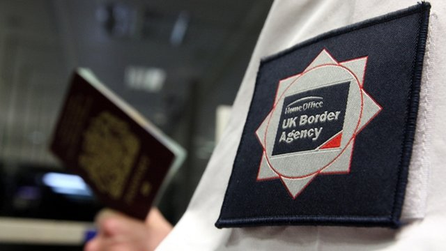 UK Border Agency officer at Passport Control
