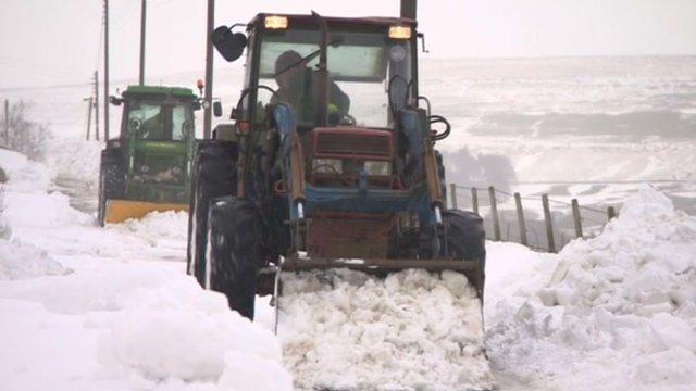 Tractors in snow