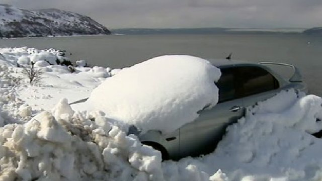 Car entombed in snow