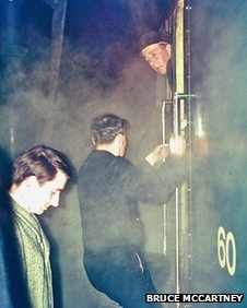 Due to the disruption at Newcastleton on the night of 5th January 1969, signalman Gordon Hall had to leave Hawick South signal box and cross to the south end of the Carlisle platform to pass a written 'permission to proceed' to Driver Fleming of the 21.56 Edinburgh-St Pancras train. Captured for posterity, David Steel MP – who was a sleeper passenger on the train – looks on as Hall climbs into the cab of 'Peak' Type 4 (aka Class 45) D60 Lytham St. Annes.