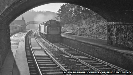 an English Electric Type 3 (aka Class 37) powers the 09.20 Carlisle-Edinburgh service non-stop through Stow in December 1968. Demonstrating the poverty of vision of local and central government, permission was given in the mid-1990s for a large bungalow to be built almost exactly where the locomotive is seen here. By the end of May 2012 the house had become, however, just a pile of rubble – awaiting the arrival of the new Borders Railway in 2015.