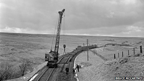 Contractors lift a section of track near Whitrope in late 1969