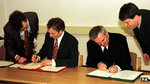 The then UK Prime Minister Tony Blair (left) and Irish Prime Minister Bertie Ahern sign the deal