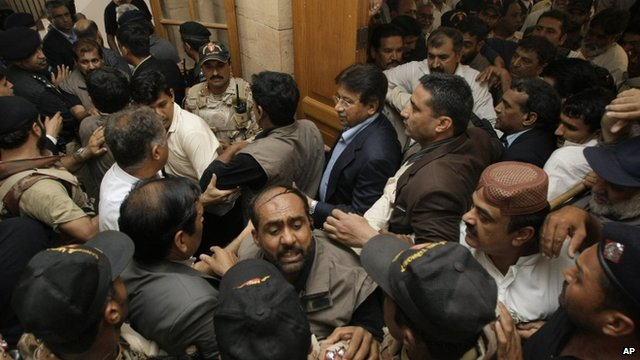 An angry lawyer threw a shoe at former President Musharraf as he entered into court