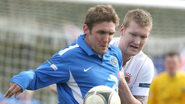 Match action from Ballinamallard against Linfield