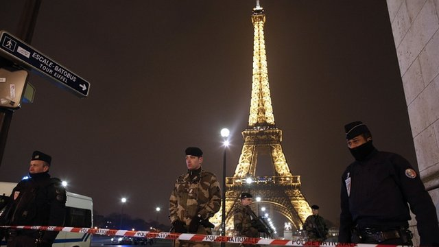 French police stand guard near the Eiffel Tower in Paris