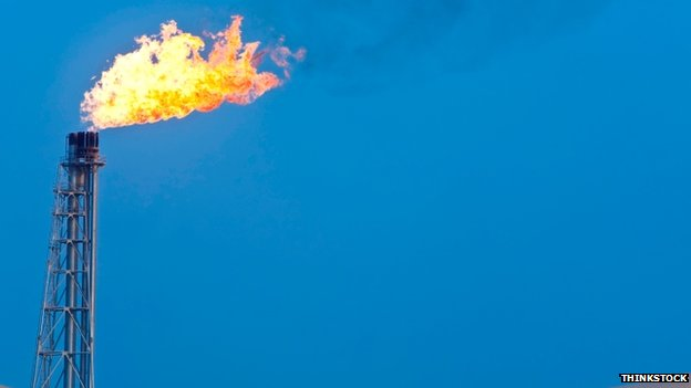 Gas flare against a blue sky