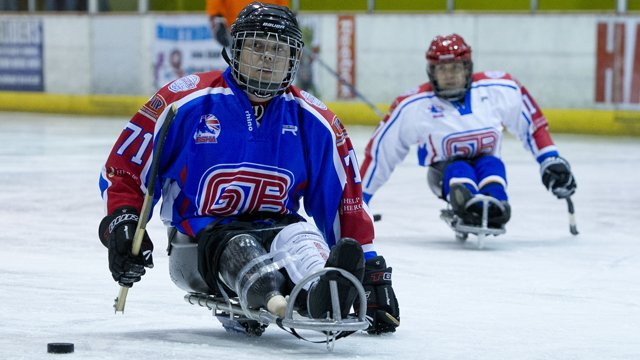 GB Paralympic sledge hockey players prepare to hit puck