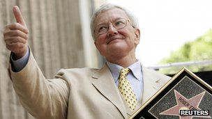 Movie critic Roger Ebert gives the thumbs-up after receiving a star on the Hollywood Walk of Fame in Hollywood in this file photo taken 23 June 2005