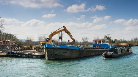 The boat delivers materials to the building site
