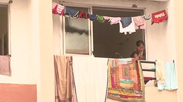 Woman on balcony in India