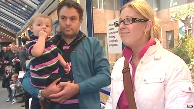 Parents in a queue to give their child the MMR vaccine