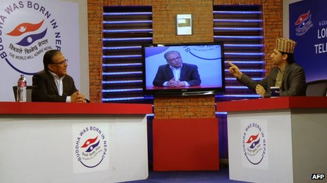 Rabi Lamichhane (right) speaks with the chairman of the Unified Communist Party of Nepal (Maoist) Pushpa Kamal Dahal (left) during the marathon broadcast