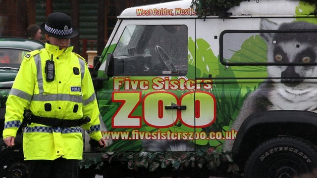 Police officer by Five Sisters Zoo vehicle