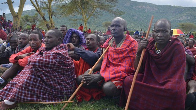 Maasai men listen to speakers at the protest in the shadow of Mt Olorien