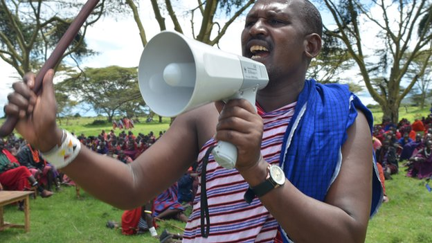 A Maasai man speaks to those assembled at Olorien