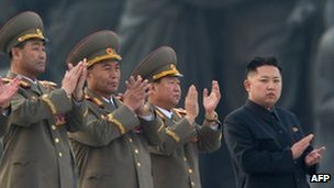 North Korean leader Kim Jong-Un (R) claps during the unveiling ceremony of two statues of former leaders Kim Il-sung and Kim Jong-il in Pyongyang 13 April 2013