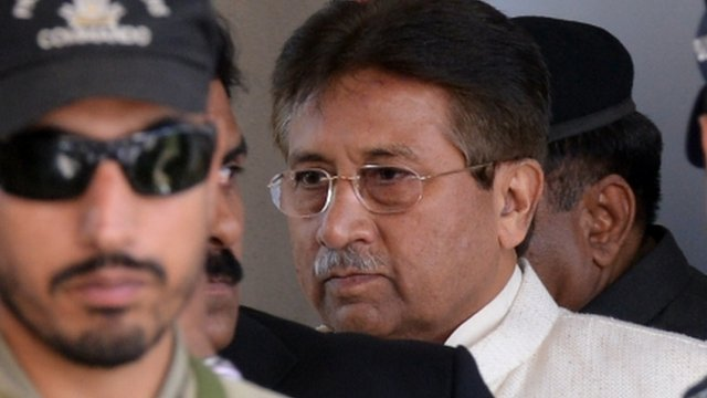 Former Pakistani president Pervez Musharraf (R) is escorted by paramilitary soldiers as he leaves the Pindi High Court