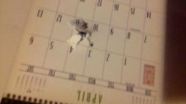 Bullet hole through student's calendar