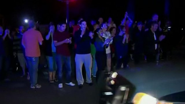 Crowds cheer police cars in Boston