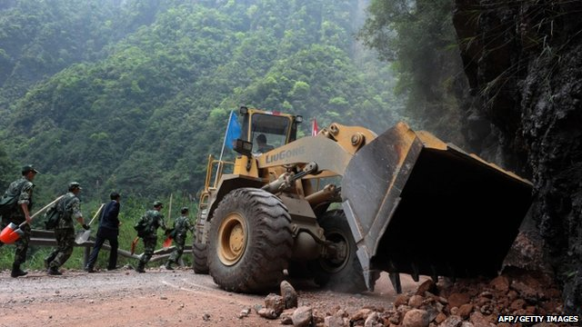 An excavator clearing up a road in China's Sichuan province