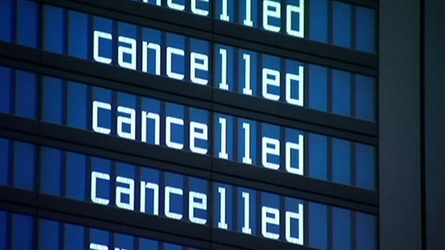 A departure sign reading cancelled