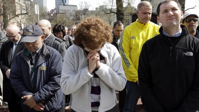 People pause for a moment of silence in Boston