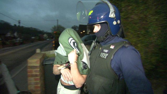 Policeman escorts man