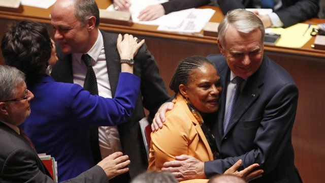 French Prime Minister Jean-Marc Ayrault hugs Justice Minister Christiane Taubira