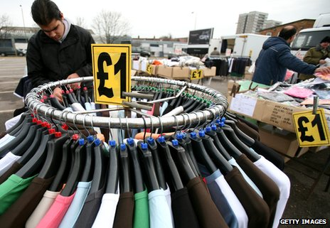 A man looks at clothing on a rail at Wimbledon car boot sale and market in 2009