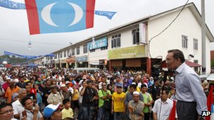 Malaysian opposition leader Anwar Ibrahim, right, speaks during an election campaign in Lubok China, Melaka state, Malaysia