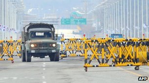 A South Korean military vehicle drives past barricades on the road leading to North Korea's Kaesong industrial complex, at a military checkpoint in the border city of Paju on 25 April 2013