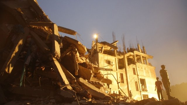 Rescue workers at the collapsed garment factory