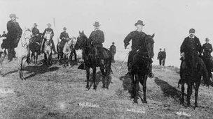 Men on horseback in an archival photo