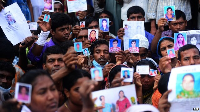 Bangladeshi relatives hold photos of the missing workers