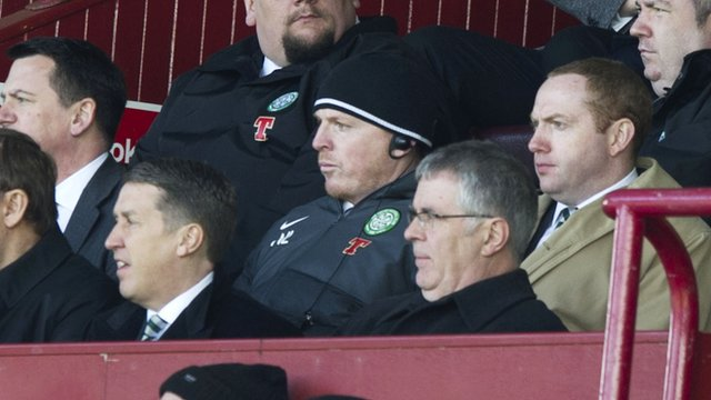 Celtic manager Neil Lennon watches the game from the stand