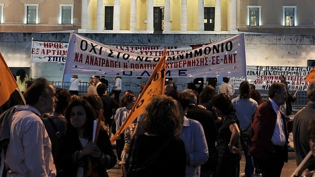 Demonstrators protest in front of parliament in Athens
