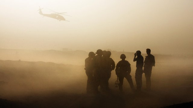 British soldiers silhouetted during training in Helmand