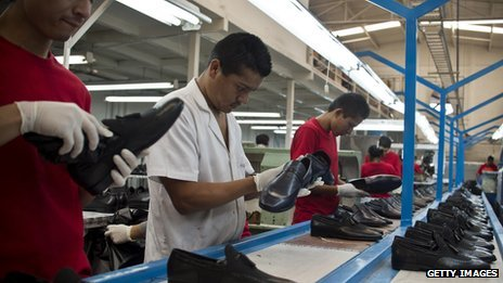 Men work on an assembly line at a Mexican shoe factory
