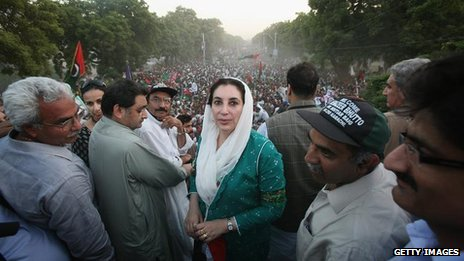 Benazir Bhutto poses for a photograph on the Pakistani Peoples Party bus on her welcome home parade on October 18, 2007