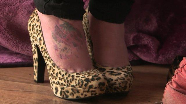 Gemma Hardy's feet with blotchy tattoo