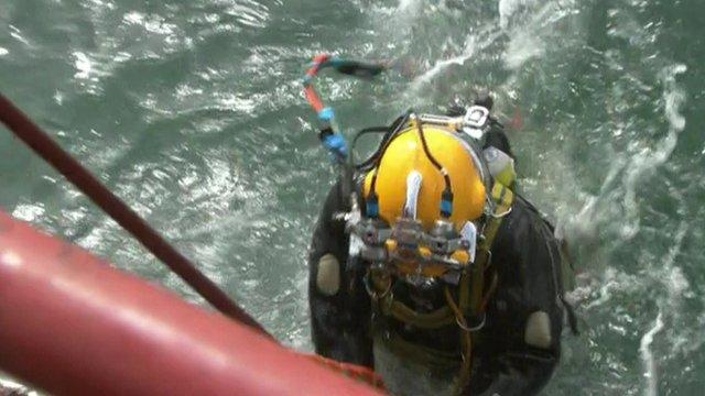 Diver working on the salvage of German World War II Dornier 17 bomber