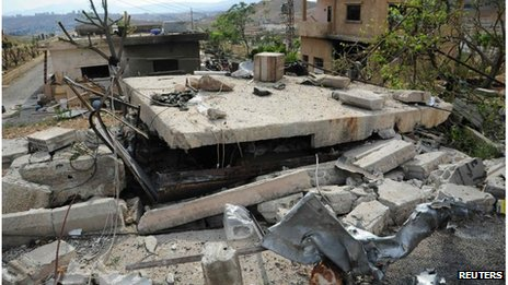 Picture from Syrian national news agency Sana, which it says shows damage after an Israeli air strike near Damascus (05/05/13)